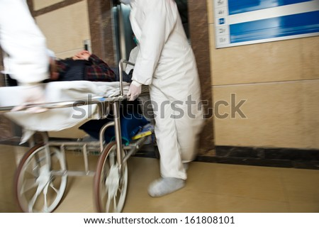 Rushing a patient to the emergency room. motion blur - stock photo
