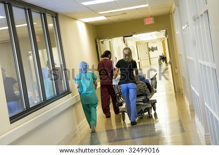 Rushing a patient to the hospital emergency operating room for surgery providing modern Health Care - stock photo