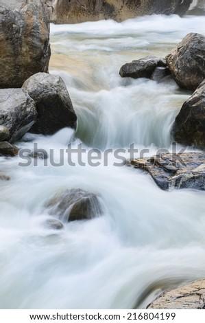 Rushing water in stream - stock photo