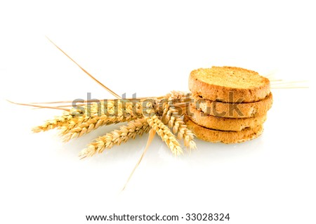 Rusk with wheat ear on white background - stock photo