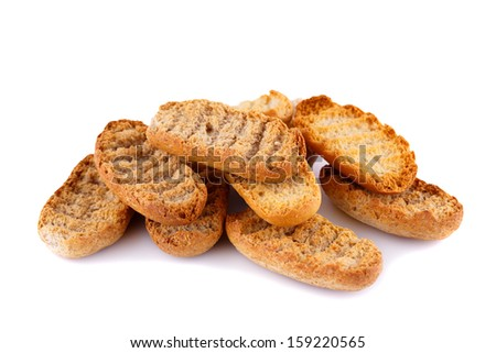 Rusks  isolated on white background. - stock photo