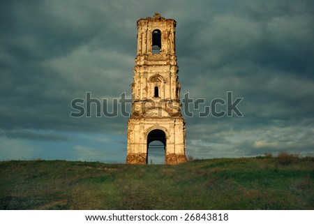 Russa. The Kachalino. The ruins of old belt-tower of the nineteenth centure in dark blue sky.