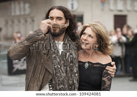 Russell Brand and mother arriving for the Rock Of Ages Premiere, Odeon Leicester Square, London. 10/06/2012 Picture by: Simon Burchell / Featureflash - stock photo