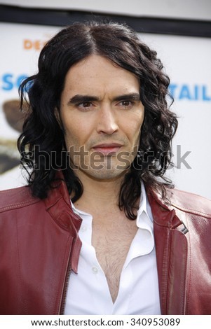 """Russell Brand at the Los Angeles Premiere of """"Hop"""" held at the Universal Studios Hollywood in Los Angeles, California, United States on March 27, 2011.   - stock photo"""