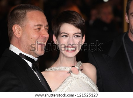 Russell Crowe and Anne Hathaway arriving for the premiere of 'Les Miserables' at Leicester Square, London. 05/12/2012 Picture by: Alexandra Glen - stock photo