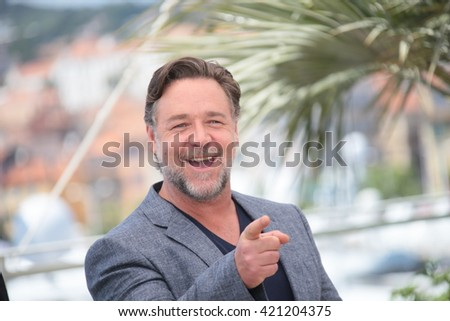 Russell Crowe making selfies at The Nice Guys' photocall during the 69th annual Cannes Film Festival at the Palais des Festivals on May 15, 2016 in Cannes . - stock photo