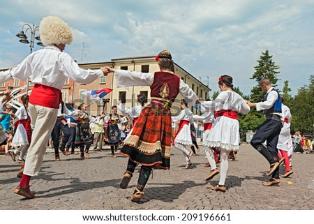 """RUSSI, RA, ITALY - AUGUST 3: folk dance group """"Folklore ensemble Saint George's Church"""" from Belgrade, Serbia at the International Folklore Festival of Russi, on August 3, 2014 in Russi, RA, Italy   - stock photo"""