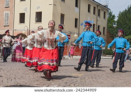 "RUSSI, RA, ITALY - AUGUST 3: the folk group ""Cossack song and dance ensemble Volnaya Step"" from Stavropol, Russia, at the International Folklore Festival on August 3, 2014 in Russi, RA, Italy"