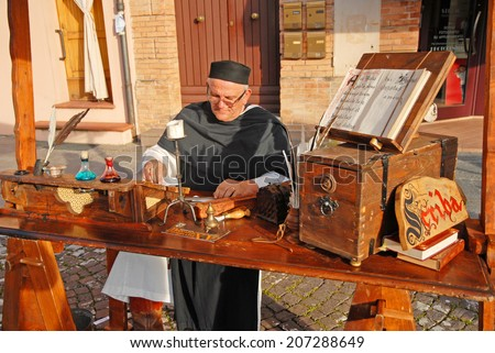 RUSSI, RAVENNA, ITALY- MARCH 30, 2014: Medieval writer at the Seven Sorrows annual fair. The exhibition is very popular in the city and attracts thousands of people. - stock photo
