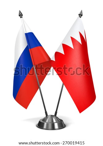 Russia and Bahrain - Miniature Flags Isolated on White Background. - stock photo