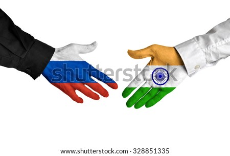 Russia and India leaders shaking hands on a deal agreement - stock photo