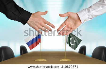 Russia and Pakistan diplomats agreeing on a deal - stock photo