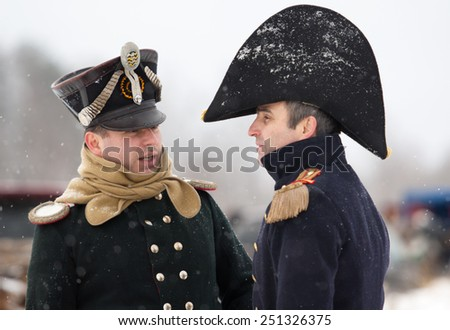 RUSSIA, APRELEVKA - FEBRUARY 7: Unidentified two napoleonic officers speaks on reenactment of the Napoleonic maneuvers near the Aprelevka city, in 1812. Moscow region, 7 February, 2015, Russia