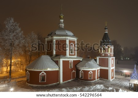 Russia. Assumption Church with a bell tower on the territory of the Suzdal Kremlin in winter night. (inscription: Suzdal)