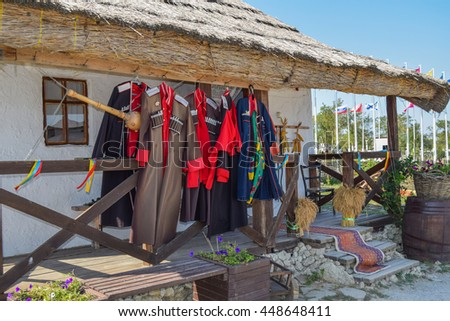 Russia, Ataman - 26 September 2015: Cossack upper uniforms hanging on the veranda. Drying Cossack form.