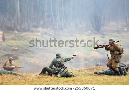 RUSSIA, BORODINO - OCTOBER 12: Unidentified armed soldiers fights and shooting on reenactment of the battle in WWII near the Borodino village in 1941, in Moscow region,  on 12 October, 2014, Russia - stock photo