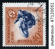RUSSIA - CIRCA 1959: A stamp printed by Russia, shows motorcycle and racer, circa 1959 - stock photo