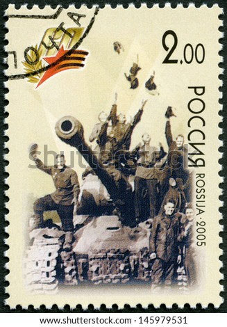 RUSSIA - CIRCA 2005: A stamp printed in Russia shows Victory May 9, 1945, Berlin (triumphant soldiers on a tank), 60th anniversary of Victory in the Great Patriotic War of 1941-1945, circa 2005 - stock photo