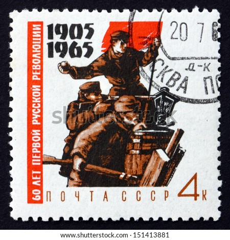 RUSSIA - CIRCA 1965: a stamp printed in the Russia shows Fighters on Barricades with Red Flag, 60th Anniversary of the 1905 Revolution, circa 1965