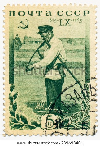 RUSSIA - CIRCA 1935: A stamp printed in USSR, shows Haymaker from the village Verhnyaya Troitsa - the birthplace of Soviet revolutionary Mikhail Kalinin, circa 1935 - stock photo