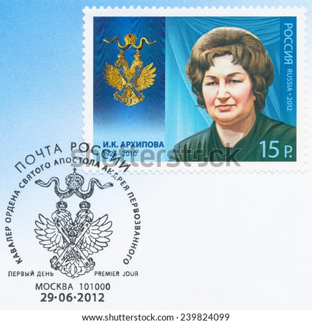 RUSSIA - CIRCA 2012: A stamp printed in USSR, shows portrait of Irina Arkhipova (1925-2010) Soviet and Russian opera singer, series Knight of St. Andrew, circa 2012 - stock photo