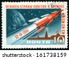 RUSSIA - CIRCA 1961: post stamp printed in USSR (CCCP, soviet union) shows rocket, Yuri A. Gagarin with helmet and Moscow Kremlin; April 12 1961, Scott 2465 A1254 10k blue red brown, circa 1961 - stock photo