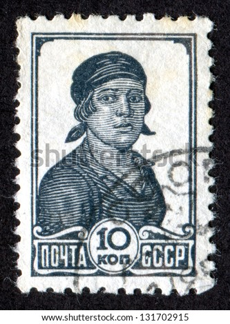 RUSSIA - CIRCA 1938: Postage stamp printed in the USSR (Soviet Union) shows a Factory Worker. Scott Catalog 616 A109 10k, circa 1938