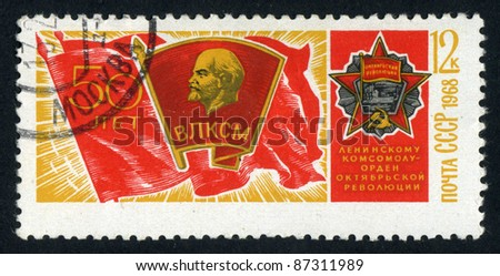 RUSSIA - CIRCA 1968: stamp printed by Russia, shows Flag with portraits of Lenin and Order, circa 1968 - stock photo