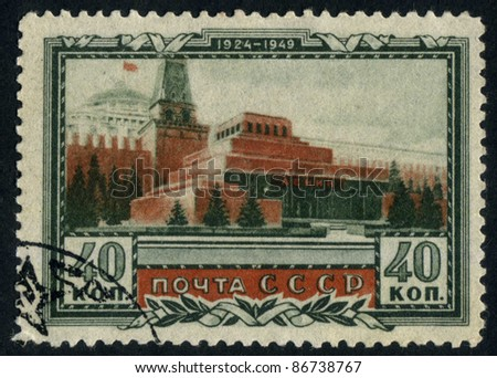 RUSSIA - CIRCA 1949: stamp printed by Russia, shows Moscow Kremlin and Mausoleum, circa 1949 - stock photo