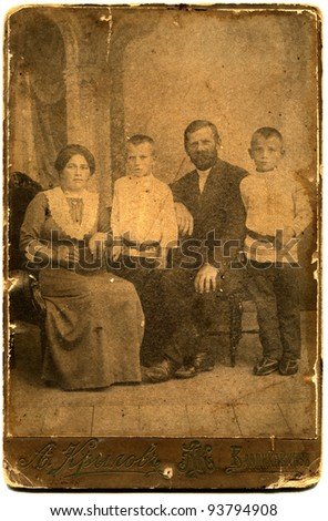 RUSSIA - CIRCA  the end of 19 - early 20century: An antique photo shows married couple with two sons, Vladikavkaz, the Russian Empire Russian text: Krylov (photographer), Vladikavkaz