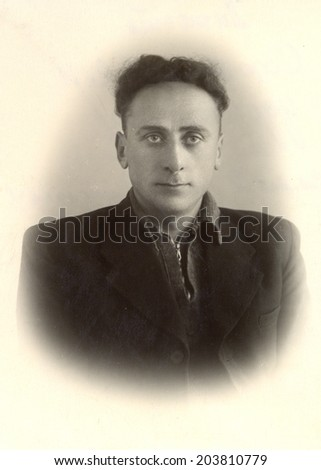 Russia - CIRCA 1954: vintage studio portrait of a man, circa 1954 - stock photo