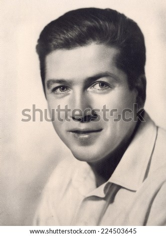 Russia - CIRCA 1962: vintage studio portrait of a young man, circa 1962 - stock photo