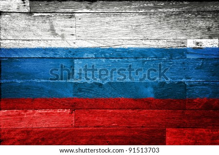russia flag painted on old wood background - stock photo