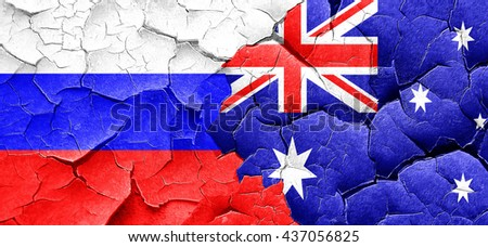Russia flag with Australia flag on a grunge cracked wall