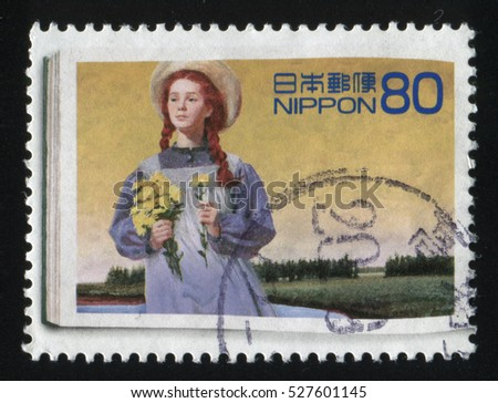 RUSSIA KALININGRAD, 22 APRIL 2016: stamp printed by Japan, shows red haired girl with bunch of dandelions in her hands, circa 2013