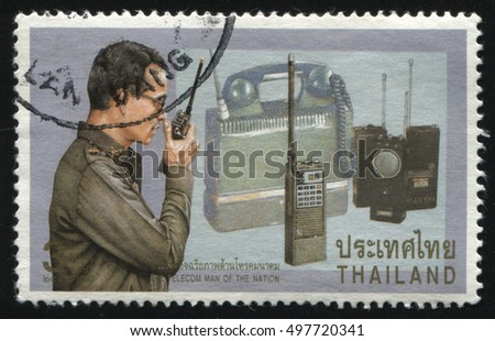 RUSSIA KALININGRAD, 2 JUNE 2016: stamp printed by Thailand, shows King using hand-held radio for communication in local areas, circa 1997