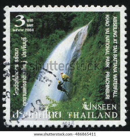 RUSSIA KALININGRAD, 4 JUNE 2016: stamp printed by Thailand, shows people, climbing on the Abseiling At Tan Rattana Waterfall in Khao Yai National Park Prachinburi, circa 2014
