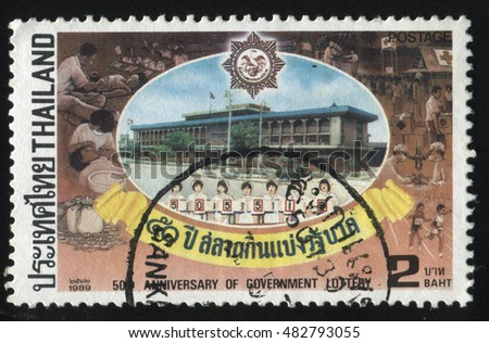 RUSSIA KALININGRAD, 2 JUNE 2016: stamp printed by Thailand, shows people on government lottery building background, circa 1989