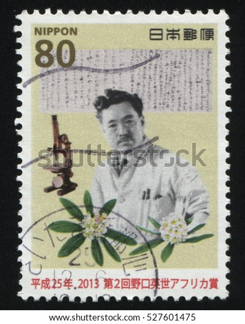 RUSSIA KALININGRAD, 18 MARCH 2016: stamp printed by Japan, shows man in laboratory coat with microscope and paper with notes, circa 2013