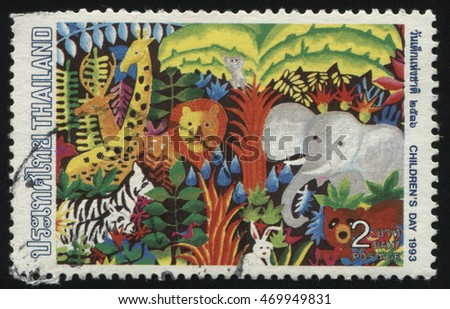 RUSSIA KALININGRAD, 31 MAY 2016: stamp printed by Thailand, shows cartoon animals in the forest, circa 1993