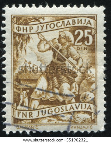 RUSSIA KALININGRAD, 12 NOVEMBER 2016: stamp printed by Yugoslavia, shows a woman worcing in the field, circa 1950