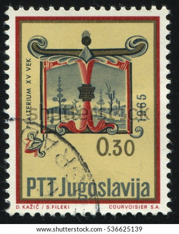 RUSSIA KALININGRAD, 12 NOVEMBER 2016: stamp printed by Yugoslaviya, shows a letter T from medieval manuscripts , circa 1966