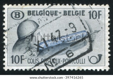 RUSSIA KALININGRAD, 20 OCTOBER 2015: stamp printed by Belgium, shows Crossbowman with Train, circa 1947