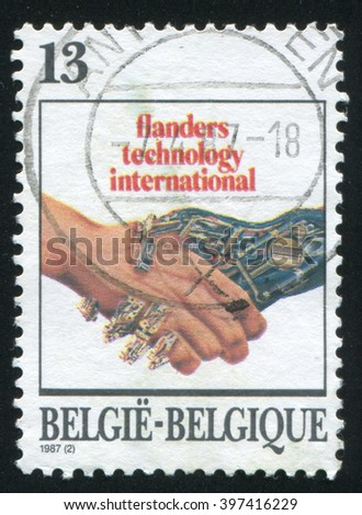 RUSSIA KALININGRAD, 20 OCTOBER 2015: stamp printed by Belgium, shows handshake, circa 1987 - stock photo