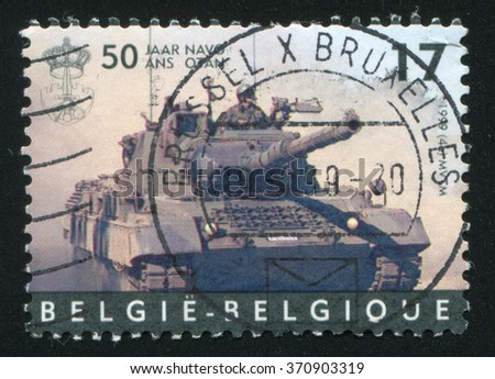 RUSSIA KALININGRAD, 19 OCTOBER 2015: stamp printed by Belgium, shows Leopard tank, NATO, circa 1999
