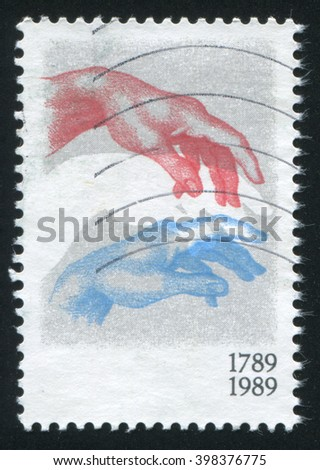 RUSSIA KALININGRAD, 20 OCTOBER 2015: stamp printed by Belgium, shows Two arms, circa 1989 - stock photo