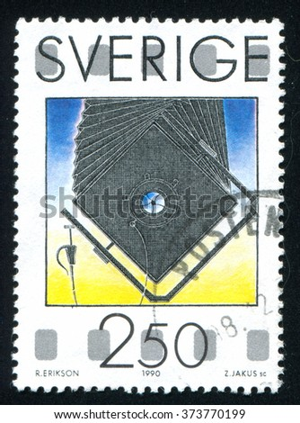 RUSSIA KALININGRAD, 6 OCTOBER 2013: stamp printed by Sweden, shows Bellows camera, circa 1990 - stock photo