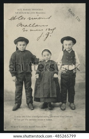 RUSSIA KALININGRAD, 19 SEPTEMBER 2016: postcard printed by France shows Three children, circa 1900