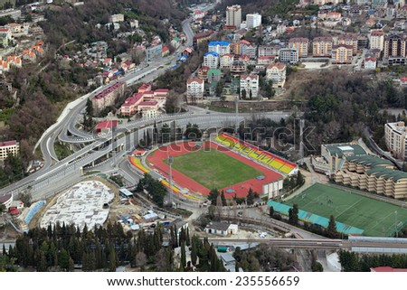 Russia, Krasnodar krai, Sochi cityscape, top view on the street Bzugu, Kurortniy prospect and Sochi Central Stadium - stock photo
