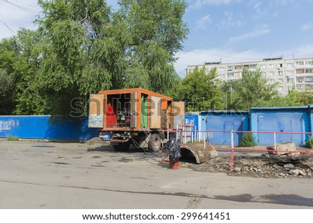 Russia Krasnoyarsk on July 21, 2015: preparatory work on replacement of a heating main, preparation for a heating season, the mobile generator for electric welding at installation of heating mains